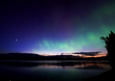 Aurora on Puntchesakut Lake By Chris Lahoda